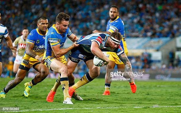 Chris McQueen of the Titans scores a try during the round 20 NRL match between the Gold Coast Titans and the Parramatta Eels at Cbus Super Stadium on...