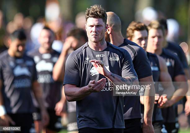 Chris McQueen thanks the fans during a South Sydney Rabbitohs NRL training session at Redfern Oval on September 29 2014 in Sydney Australia