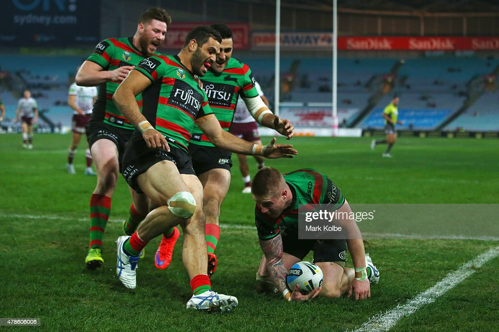 Chris McQueen,Greg Inglis and Bryson Goodwin of the Rabbitohs celebrate with Aaron Gray of the Rabbitohs after he scored a try during the round 16 NRL match between the South Sydney Rabbitohs and the Manly Sea Eagles at ANZ Stadium on June 26, 2015 in Sydney, Australia.