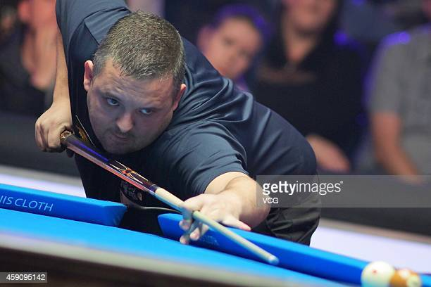 Chris Melling of UK plays a shot against Shane Van Boening of USA during the semifinal of 2014 Partypoker World Pool Masters on November 16 2014 in...