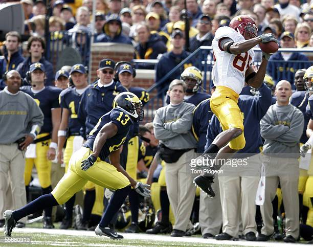 Chris Mensen of Minnesota catches a pass near Grant Mason of Michigan on October 8 2005 at Michigan Stadium in Ann Arbor Michigan The pass was...