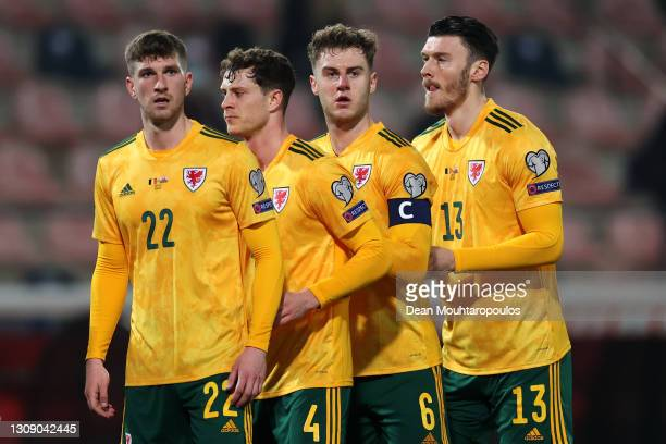 Chris Mepham, Jamie Lawrence, Joe Rodon and Kieffer Moore of Wales look on during the FIFA World Cup 2022 Qatar qualifying match between Belgium and...