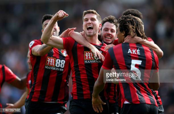 Chris Mepham of AFC Bournemouth celebrates with teammates after scoring his team's first goal during the Premier League match between AFC Bournemouth...