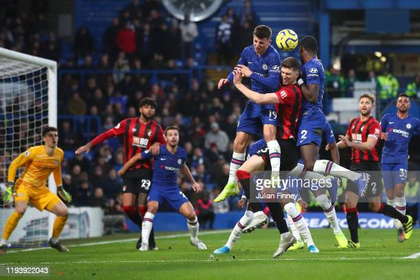 Chris Mepham of AFC Bournemouth competes for a header with Mason Mount and Antonio Rudiger of Chelsea during the Premier League match between Chelsea...