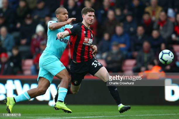 Chris Mepham of AFC Bournemouth is challenged by Salomon Rondon of Newcastle United during the Premier League match between AFC Bournemouth and...