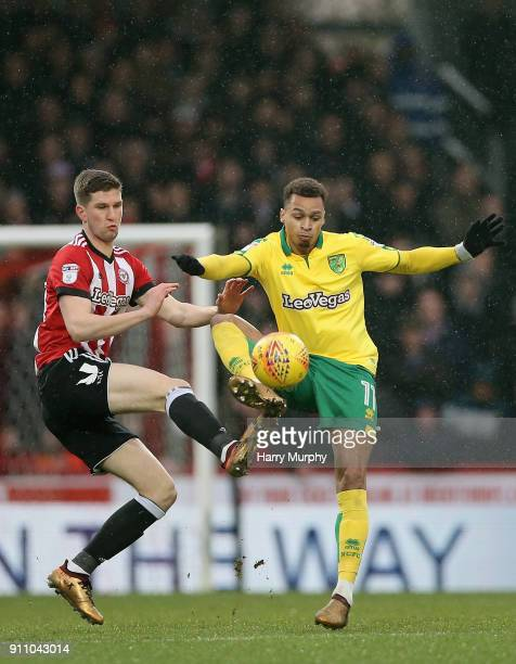Chris Mepham of Brentford and Josh Murphy of Norwich City battle for possession during the Sky Bet Championship match between Brentford and Norwich...