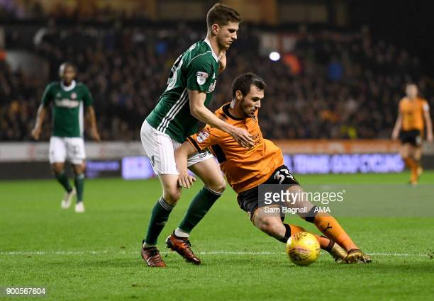 Chris Mepham of Brentford and Leo Bonatini of Wolverhampton Wanderers during the Sky Bet Championship match between Wolverhampton and Brentford at...