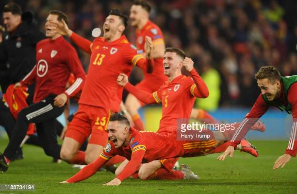 Chris Mepham of Wales and Connor Roberts of Wales celebrate with their team mates after the UEFA Euro 2020 qualifier between Wales and Hungary so at...