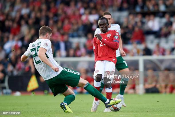 Chris Mepham of Wales and Pione Sisto of Denmark compete for the ball during the UEFA Nations League match between Denmark and Wales at Ceres Park on...