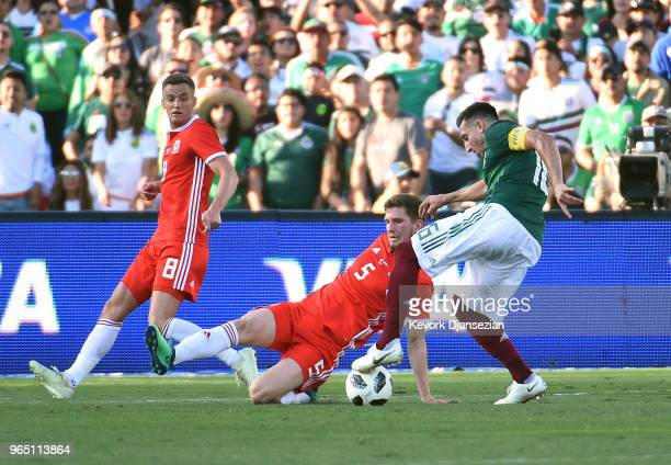 Chris Mepham of Wales attempts to block a shot on goal by Hector Herrera of Mexico during the first half of their friendly international soccer match...