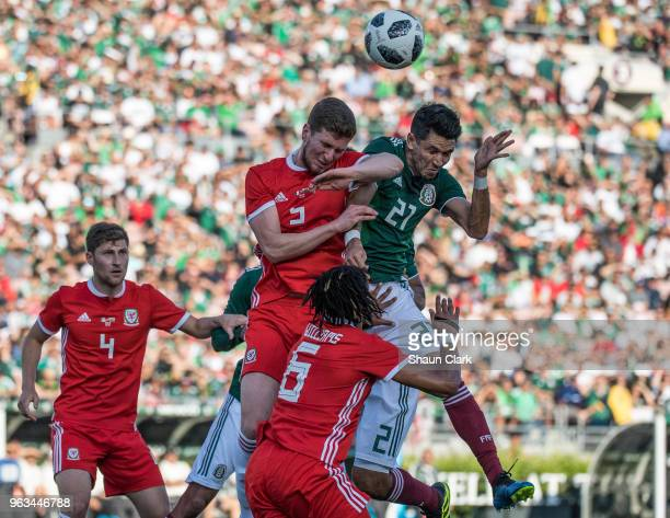 Chris Mepham of Wales battles Jesus Molina of Mexico during the international friendly match between Mexico and Wales at the Rose Bowl on May 28 2018...