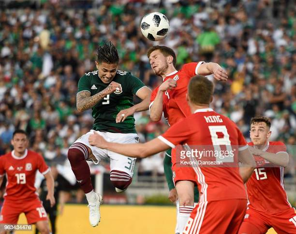 Chris Mepham of Wales clears the ball against Carlos Salcedo after a corner kick by Mexico during the second half of their friendly international...