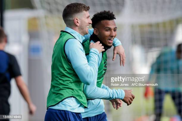 Chris Mepham with Lloyd Kelly of Bournemouth during a training session at the Vitality Stadium on October 14, 2021 in Bournemouth, England.