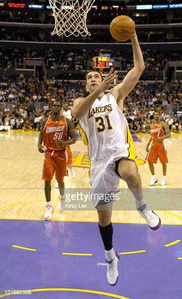 Chris Mihm of the Los Angeles Lakers dunks during the NBA game between the Los Angeles Lakers and the Charlotte Bobcats at the Staples Center in Los...