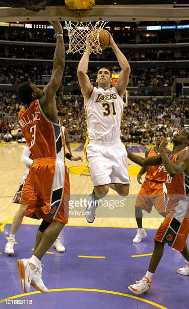 Chris Mihm of the Los Angeles Lakers goes up for a shot during the NBA game between the Los Angeles Lakers and the Charlotte Bobcats at the Staples...