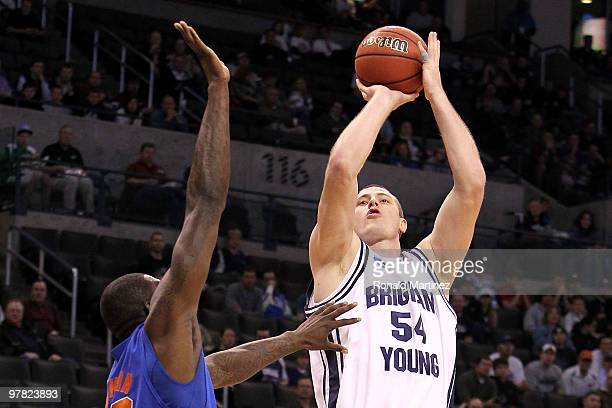 Chris Miles of the BYU Cougars attempts a shot against Vernon Macklin the Florida Gators during the first round of the 2010 NCAA men�s basketball...