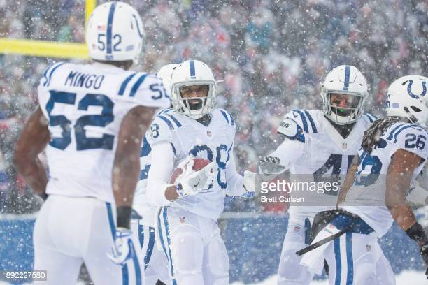 Chris Milton of the Indianapolis Colts celebrates downing a punt deep in the Buffalo Bills defensive end during the second quarter at New Era Field...