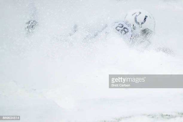 Chris Milton of the Indianapolis Colts is covered in snow during the second quarter against the Buffalo Bills on December 10 2017 at New Era Field in...