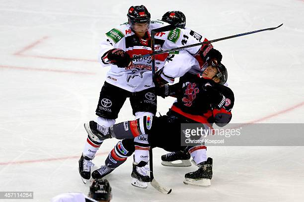 Chris Minard of Koelner Haie knocks down Ken Andre Olimb of Duesseldorfer EG during the DEL match between Duesseldorfer EG and Koelner Haie at ISS...
