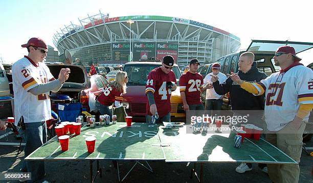 Chris Mitchell left of Annandale Va takes aim while playing Beer Pong outside FedEx Field with his friends including Fred Lynch far right of Prince...