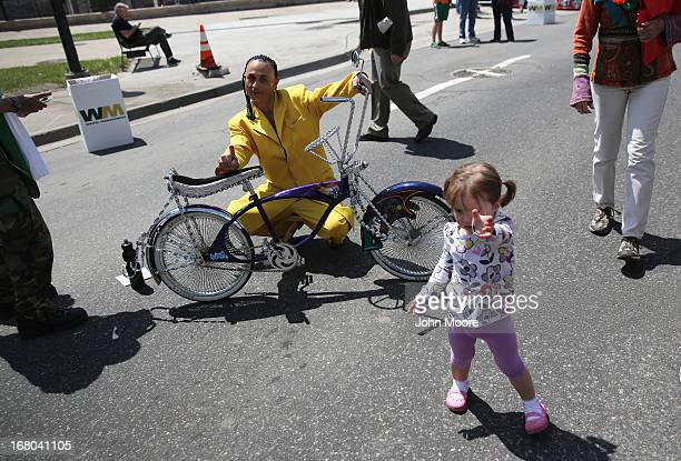 Chris Montoya shows off his low rider bike at a Cinco de Mayo festival on May 4 2013 in Denver Colorado Hundreds of thousands of people were expected...