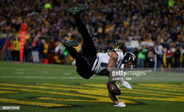 Chris Moore of the Baltimore Ravens celebrates after a 30 yard touchdown reception in the second quarter during the game against the Pittsburgh...