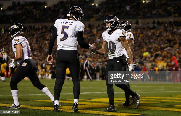 Chris Moore of the Baltimore Ravens celebrates with Joe Flacco after a 30 yard touchdown reception in the second quarter during the game against the...