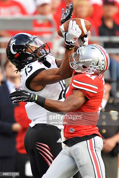 Chris Moore of the Cincinnati Bearcats pulls in a 60yard touchdown pass in the first quarter over the defense of Vonn Bell of the Ohio State Buckeyes...