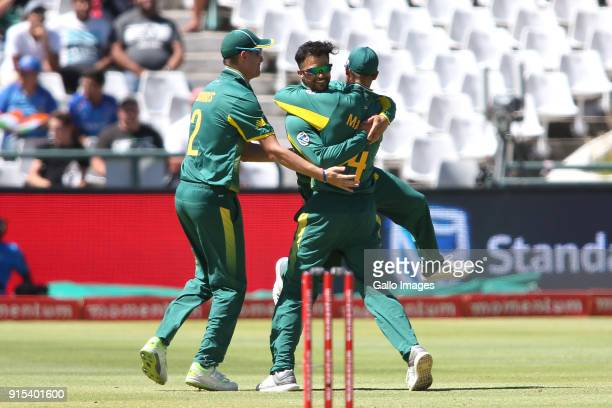 Chris Morris of South Africa and South African captain Aiden Markram congratulate JP Duminy of South Africa for getting Ajinkya Rahane of India...
