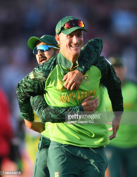Chris Morris of South Africa celebrates after taking a catch to dismiss David Warner of Australia with Tabraiz Shamsi of South Africa during the...