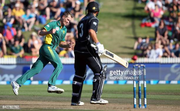 Chris Morris of South Africa celebrates taking the catch to dismiss Ross Taylor of New Zealand during the oneday international cricket match between...
