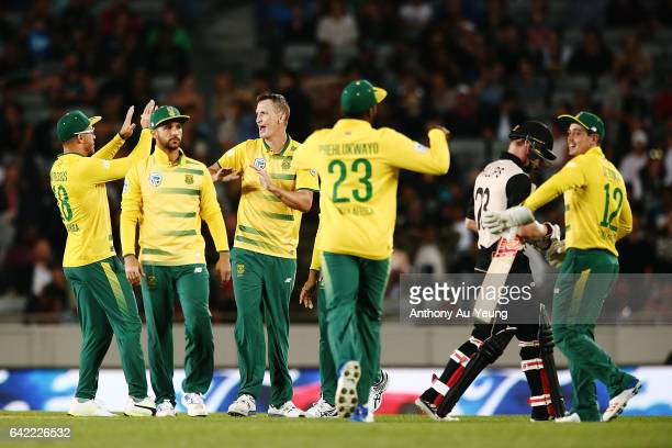 Chris Morris of South Africa celebrates with teammates for the wicket of Glenn Phillips of New Zealand during the first International Twenty20 match...