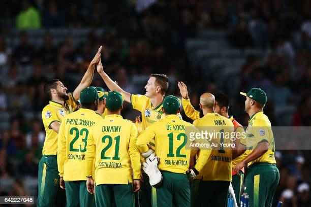 Chris Morris of South Africa celebrates with teammates for the wicket of Colin Munro of New Zealand during the first International Twenty20 match...