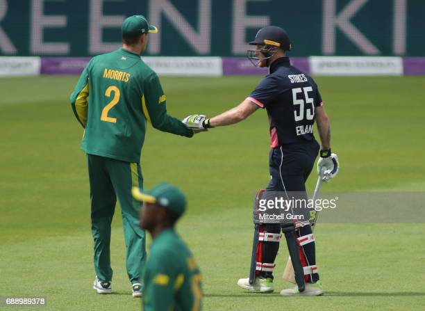 Chris Morris of South Africa shakes hands with Ben Stokes of England after he was dismissed on 101 runs during the 2nd Royal London One day...