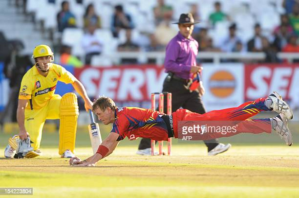 Chris Morris of the Highveld Lions saves a certain foundry off his own bowling on October 16 2012 during Match 7 of the Champions League T20 between...