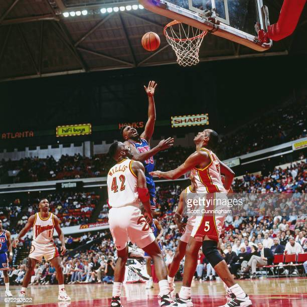 Chris Morris of the New Jersey Nets shoots against the Atlanta Hawks during a game played circa 1990 at the Omni in Atlanta Georgia NOTE TO USER User...