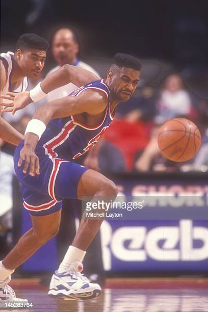 Chris Morris of the New Jersey Nets tries to get a loose ball during a basketball game against the Washington Bullets at the Capitol Centre on March...