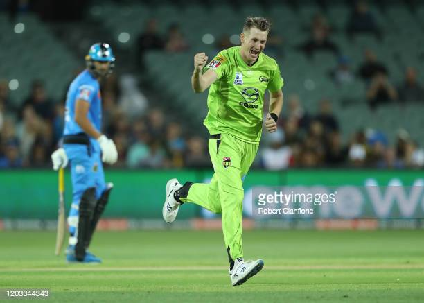 Chris Morris of the Sydney Thunder celebrates taking the wicket of Jonathan Wells of the Strikers during the Big bash League Finals match between the...