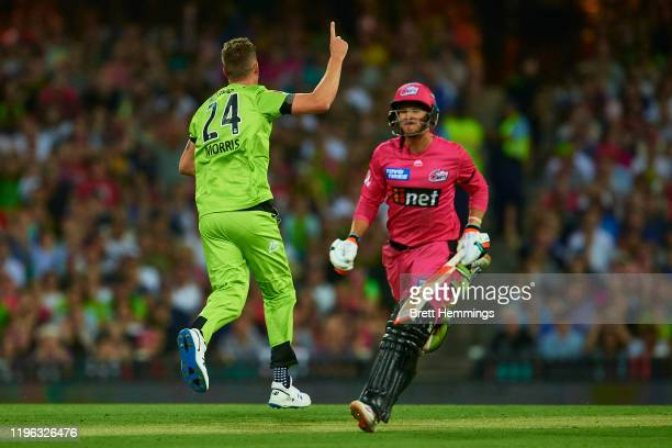 Chris Morris of the Thunder celebrates after taking the wicket of Josh Philippe of the Sixers during the Big Bash League match between the Sydney...
