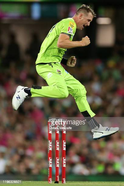 Chris Morris of the Thunder celebrates taking the wicket of Josh Philippe of the Sixers during the Big Bash League match between the Sydney Sixers...