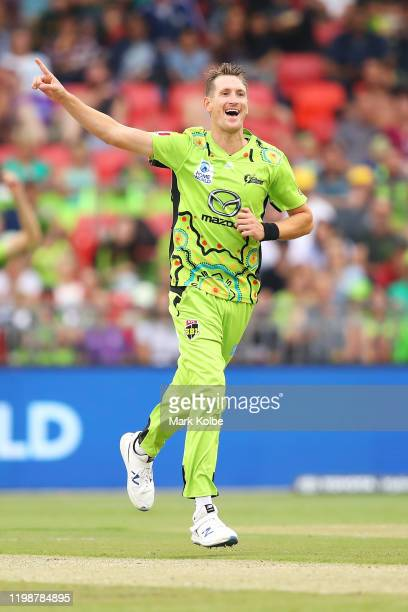 Chris Morris of the Thunder celebrates taking the wicket of Simon Milenko of the Hurricanes during the Big Bash League match between the Sydney...
