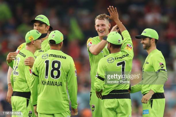Chris Morris of the Thunder celebrates with team mates after claiming the wicket of Rashid Khan of the Strikers during the Big Bash League match...