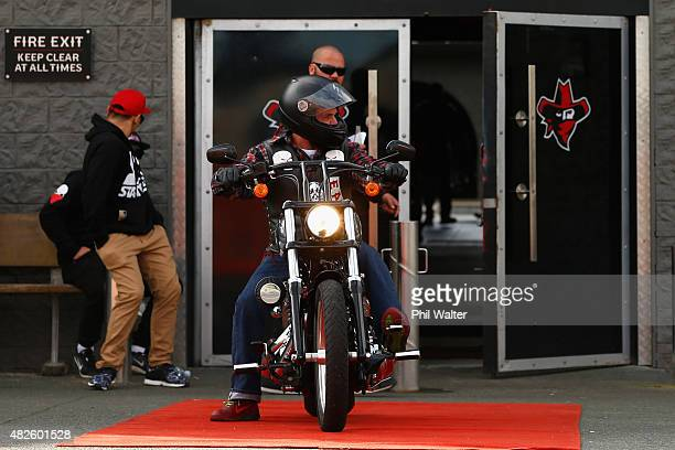 Chris Morris the father of the late Connor Morris leaves on his sons old bike following a memorial ride on August 1 2015 in Auckland New Zealand More...