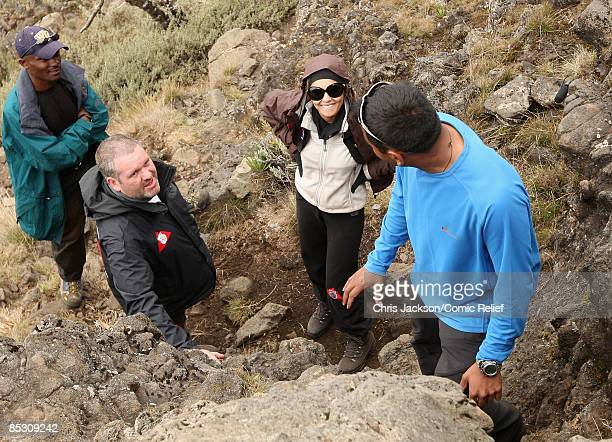Chris Moyles and Cheryl Cole prepare to climb up a steep bit of path on the second day of The BT Red Nose Climb of Kilimanjaro on March 1 2009 in...