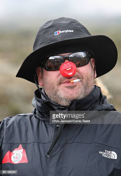 Chris Moyles smokes a cigarette as he sets out early in the morning on the third day of The BT Red Nose Climb of Kilimanjaro on March 3 2009 in...