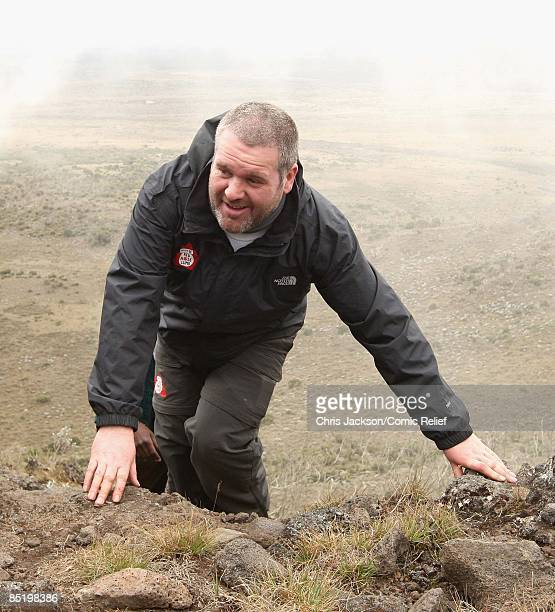 Chris Moyles treks up a steep section of mountain on the second day of The BT Red Nose Climb of Kilimanjaro on March 3 2009 in Arusha Tanzania...