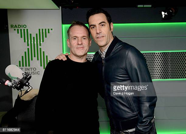 Chris Moyles with Sacha Baron Cohen at his surprise birthday party on Radio X at Global Radio Studios on February 22 2016 in London England