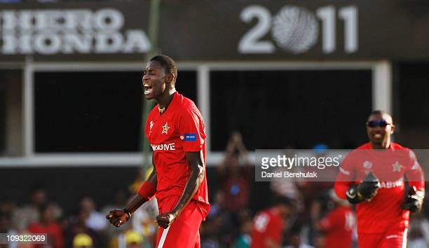 Chris Mpofu of Zimbabwe celebrates after taking the wicket of Cameron White of Australia during the 2011 ICC World Cup Group A match between...