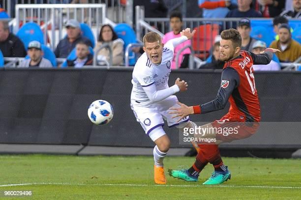 Chris Mueller and Eriq Zavaleta seen during the 2018 MLS Regular Season match between Toronto FC and Orlando City SC at BMO Field .