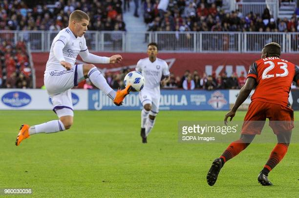 BMO FIELD TORONTO ONTARIO CANADA Chris Mueller jumping for the ball during 2018 MLS Regular Season match between Toronto FC and Orlando City SC at...